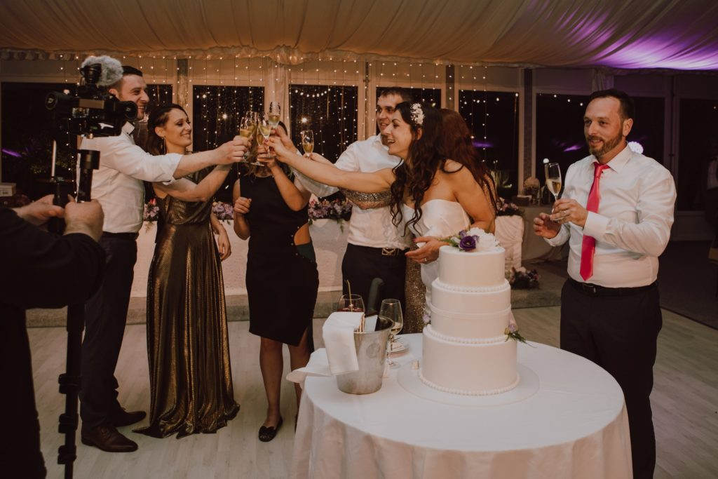 after cutting the cake, a toast follows