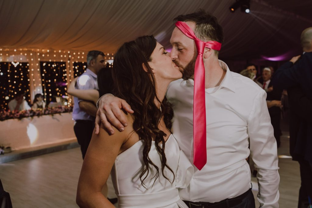 and one last kiss at a wedding party